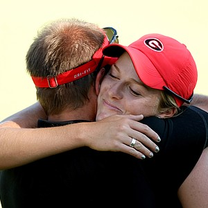 Georgia's Emilie Burger, a senior playing as an individual, shed a few tears as she hugs her coach Josh Brewer after her final round. Burger played as an individual for Georgia.