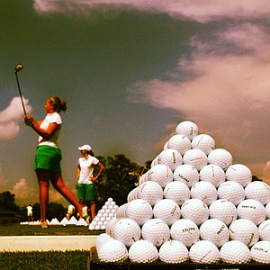 Michigan State's Trisha Witherby hits balls on the range in Round 1.