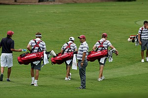 Oklahoma's assistant coach Blake Smart and his team during practice at the 2013 NCAA Championship at Capital City Club Crabapple Course.