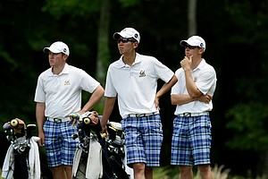 Cal's Michael Kim, center, Michael Weaver, left, and Brandon Hagy, right, during the 2013 NCAA Championship at Capital City Club Crabapple Course.