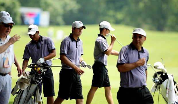 Washington's Chris Williams, center, during Monday's practice at the 2013 NCAA Championship at Capital City Club Crabapple Course.