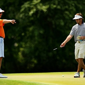 Florida's head coach Buddy Alexander, left, and A. J. Crouch during Monday's practice round at the 2013 NCAA Championship at Capital City Club Crabapple Course.