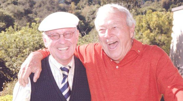 Eddie Merrins, left, with Arnold Palmer