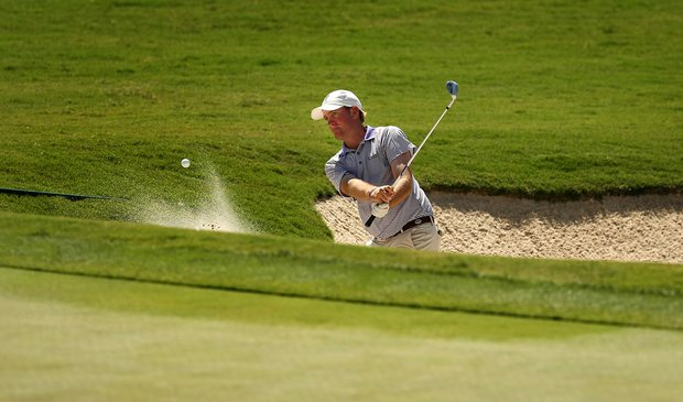 LSU's Adrew Presley plays a bunker shot during Round 1 of the 2013 NCAA Championship at Capital City Club Crabapple Course.