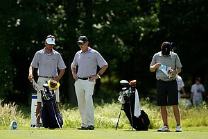 LSU head coach Chuck Winstead center with Curtis Thompson, left, far right is Talor Gooch of Oklahoma State during Round 1 of the 2013 NCAA Championship at Capital City Club Crabapple Course.