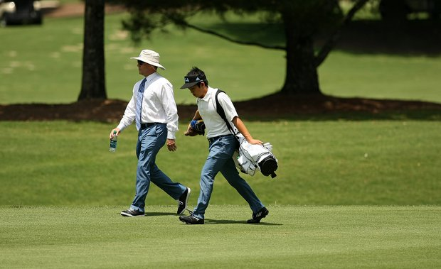 UCLA head coach Derek Freeman walks with Anton Arboleda at No. 10 during Round 1 of the 2013 NCAA Championship at Capital City Club Crabapple Course.