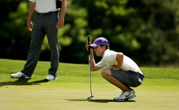 Washington's Jonathan Sanders looks over his putt at No. 11 during Round 1 of the 2013 NCAA Championship.