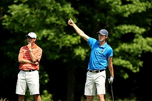 Illinois' Thomas Pieters gives his teammate a thumbs up while he waits at No. 15 during Round 1 of the 2013 NCAA Championship.