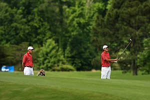 Austin Peay State head coach Kirk Kayden watches his individual player Dustin Korte during Round 2 of the 2013 NCAA Championship at Capital City Club Crabapple Course.
