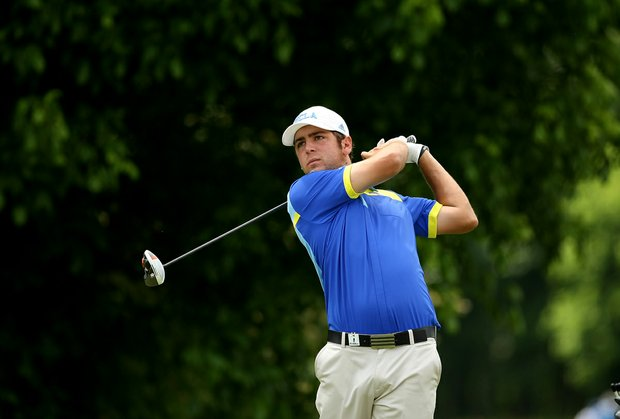 UCLA's Jonathan Garrick watches his tee shot at No. 16 during Round 2 of the 2013 NCAA Championship at Capital City Club Crabapple Course.