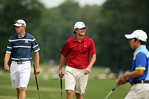 Alabama's Bobby Wyatt, center, grimaces as he misses his birdie putt at No. 15 during Round 2 of the 2013 NCAA Championship.
