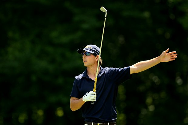 Georgia Tech's Seth Reeves signals his ball right at No. 15 during Round 2 of the 2013 NCAA Championship at Capital City Club Crabapple Course.