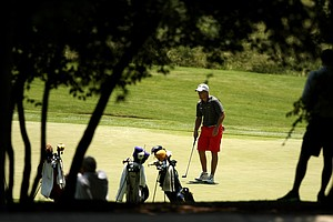Arkansas' Sebastian Cappelen putts No. 16 during Round 2 of the 2013 NCAA Championship at Capital City Club Crabapple Course.