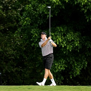 Tyler Dunlap of Texas A&M watches his tee shot at No. 16 during Round 2 of the 2013 NCAA Championship at Capital City Club Crabapple Course.