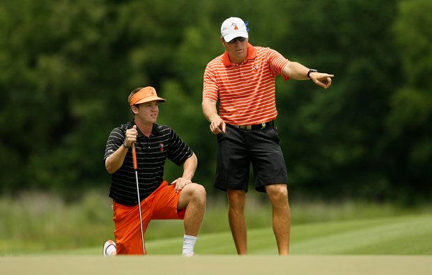 Oklahoma State assistant coach, Brian Guetz, confers with Ian Davis at No. 9 during the final round of stroke play of the 2013 NCAA Championship.