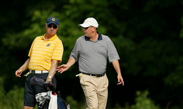 Cal head coach, Steve Desimone and Georgia Tech head coach Bruce Heppler during the final round of stroke play of the 2013 NCAA Championship.