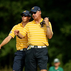 Cal's Brandon Hagy chats with head coach Steve Desimone at No. 15 during the final round of stroke play of the 2013 NCAA Championship.