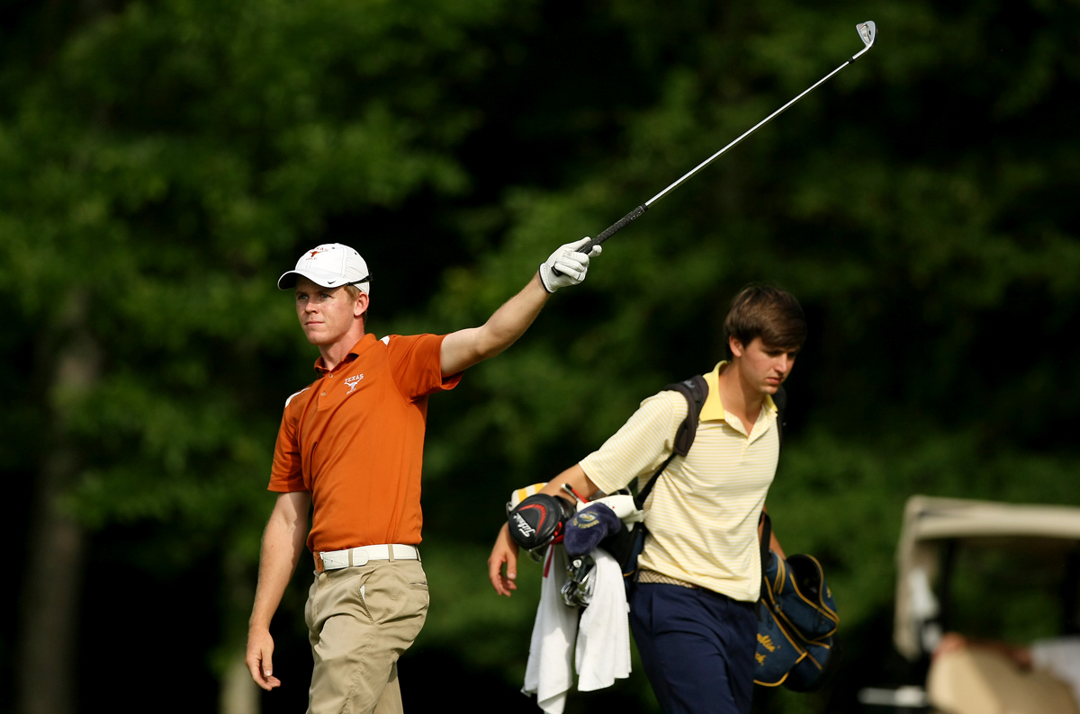 Texas' Brandon Stone signals his ball left at No. 15 during the final round of stroke play of the 2013 NCAA Championship.