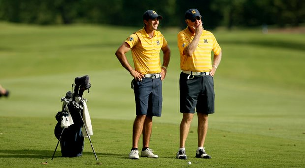 California's Max Homa with head coach Steve Desimone during the final round of stroke play of the 2013 NCAA Championship.