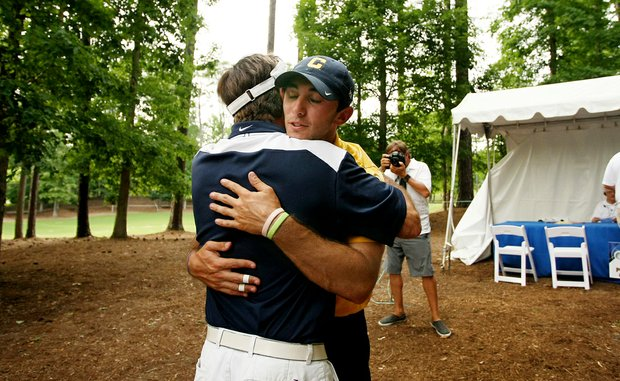 California's Max Homa gets a hug from his dad, John, after walking out of the scorers tend during the final round of stroke play of the 2013 NCAA Championship. Homa posted a 3-day total of 201 to win the individual title.
