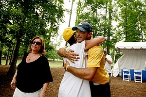 California's Max Homa gets a hug from his aunt Janis and his mom Bonnie, left, after leaving the scorers tent during the final round of stroke play of the 2013 NCAA Championship. Homa posted a 3-day total of 201 to win the individual title.