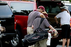 Texas A&M head coach J. T. Higgins consoles Drew Evans after his team lost in a playoff to advance to match play during the final round of stroke play of the 2013 NCAA Championship at Capital City Club Crabapple Course.