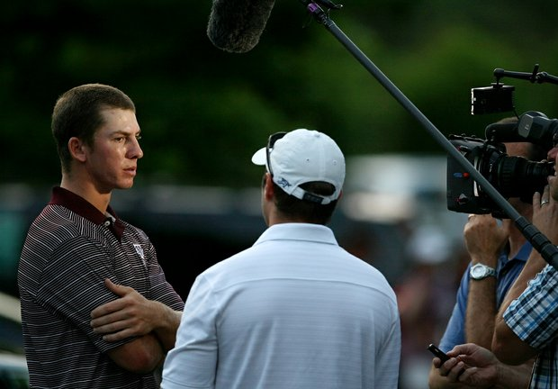 Tyler Dunlap of Texas A&M talks with the media about getting a slow play penalty and then losing in a playoff to advance to match play during the final round of stroke play of the 2013 NCAA Championship.