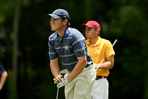 Cal's Michael Weaver grimaces while watching his tee shot at No. 15 during the quarterfinals of match play at the 2013 NCAA Championship at Capital City Club Crabapple Course.