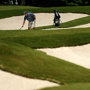 Cal's Max Homa rakes a bunker at No. 16 during the quarterfinals of match play at the 2013 NCAA Championship at Capital City Club Crabapple Course. Cal advances to play Illinois.