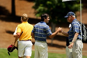 Cal's head coach Steve Desimone right congratulates his player Joel Stalter, during the quarterfinals of match play at the 2013 NCAA Championship at Capital City Club Crabapple Course.