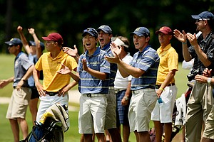 California's Michael Kim, Max Homa and Michael Weaver cheer on Brandon Hagy as he hits his second shot into No. 18 during the quarterfinals of match play at the 2013 NCAA Championship at Capital City Club Crabapple Course.