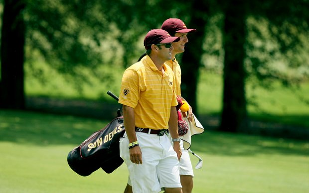 ASU head coach Tim Mickelson with Jon Rahm during the quarterfinals of match play at the 2013 NCAA Championship at Capital City Club Crabapple Course.