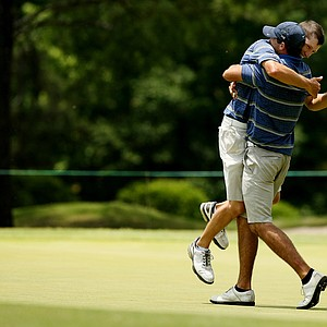 Cal's Max Homa gives Brandon Hagy a big hug after Hagy closed out his match during the quarterfinals of match play at the 2013 NCAA Championship at Capital City Club Crabapple Course.
