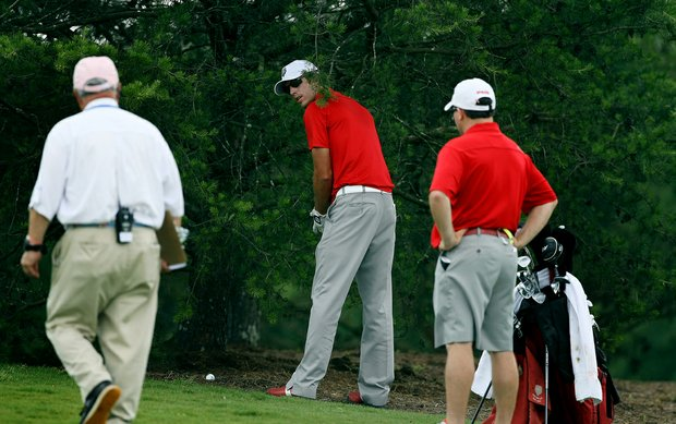 New Mexico's James Erkenbeck hit his drive into the trees at No. 11 during the quarterfinals of match play at the 2013 NCAA Championship at Capital City Club Crabapple Course. Erkenbeck lost to Justin Thomas of Alabama.