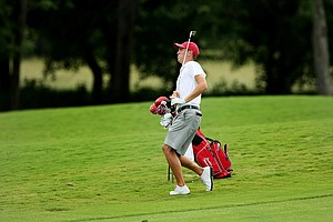 Alabama's Justin Thomas watches his shot into No. 11 during the quarterfinals of match play at the 2013 NCAA Championship at Capital City Club Crabapple Course. Thomas defeated James Erkenbeck of New Mexico, 4&3.