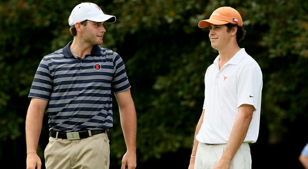 Illinois' Alex Burge talks with Cody Gribble of Texas on the first tee during the quarterfinals of match play at the 2013 NCAA Championship at Capital City Club Crabapple Course. Burge defeated Gribble, 3 and 2.