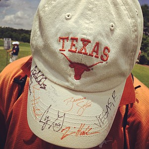 A spectator wears their very autographed Texas hat during the quarterfinals of match play at the 2013 NCAA Championship at Capital City Club Crabapple Course. Texas lost to Illinois.