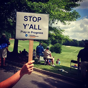 A sign stops cars passing the first tee during the quarterfinals of match play at the 2013 NCAA Championship at Capital City Club Crabapple Course.