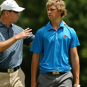 Illinois head coach Mike Small talks with Thomas Detry during the semifinals of match play at the 2013 NCAA Championship.