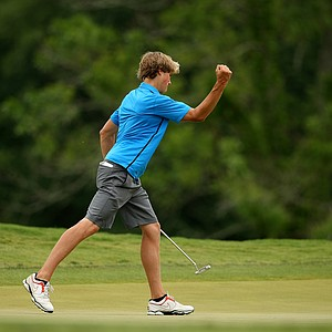 Illinois' Thomas Detry pumps his fist after making a putt at No. 16 during the semifinals of match play at the 2013 NCAA Championship at Capital City Club Crabapple Course.