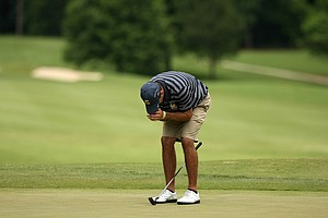 Cal's Max Homa buries his face after missing his putt to lose to Illinois' Thomas Pieters during the semifinals of match play at the 2013 NCAA Championship.