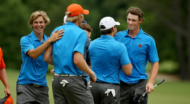 Thomas Pieters of Illinois is congratulated by his teammates after they defeated Cal to advance to the finals during the semifinals of match play at the 2013 NCAA Championship.