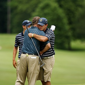 Illinois head coach Mike Small shakes hands with Cal's Max Homa after Illinois defeated Cal to advance to the finals during the semifinals of match play at the 2013 NCAA Championship.
