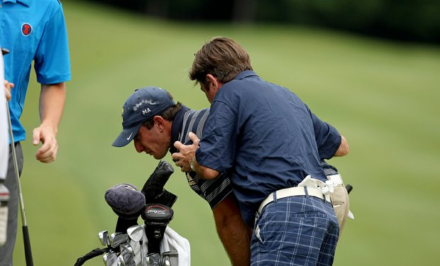 Cal's Max Homa is consoled by his father, John, after he lost his match in 20-holes to Illinois' Thomas Pieters during the semifinals of match play. Illinois advances to play Alabama in the final.
