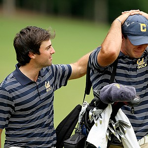 Cal's Joel Stalter consoles his teammate Max Homa after Homa lost his match to Illinois' Thomas Pieters during the semifinals of match play at the 2013 NCAA Championship.