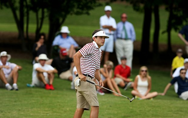 Alabama's Cory Whitsett watches his putt at No. 16 where he closed out his match against Georgia Tech's Ollie Schniederjans during the semifinals of match play at the 2013 NCAA Championship.