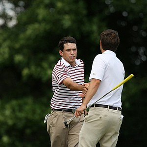 Alabama's Cory Whitsett shakes hands with Georgia Tech's Ollie Schniederjans after Whitsett won 3 and 2 during the semifinals of match play at the 2013 NCAA Championship.