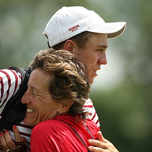 Alabama's Justin Thomas gets a hug from his mom, Jani, after he won his match during the semifinals of match play at the 2013 NCAA Championship.