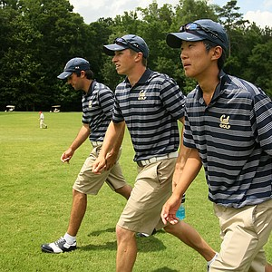 Cal's Joel Stalter, Brandon Hagy, and Michael Kim follow Max Homa's match during the semifinals of match play at the 2013 NCAA Championship. Homa lost to Illinois' Thomas Pieters.