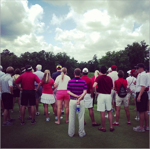 Fans look down on the sixth green during the semifinals at Capital City Club.